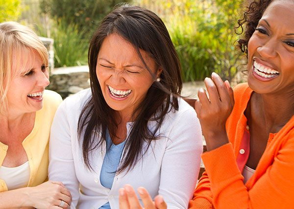 Women laughing hard urinary incontinence bladder leakage