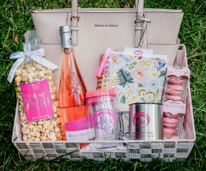 VPFW Pink Purse Raffle Gift Basket with pink michael kors purse, popcorn, mug, tervis, rose, notebook and macarons